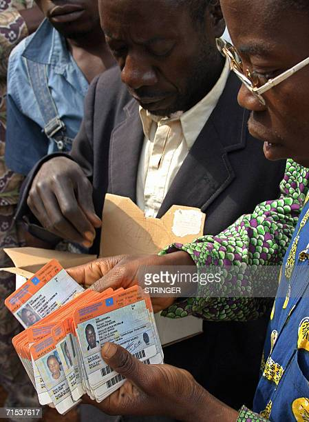 Independent Electoral Commission staff hand out last minute replacement registration cards to voters who have lost theirs in Walungu south Kivu...