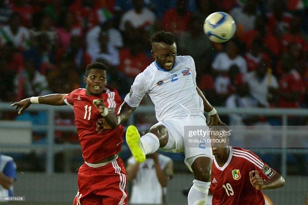 Democratic Republic of the Congo's defender Issama Mpeko (C) heads the ball during the 2015 African Cup of Nations quarter final football match between Congo and Republic of the Congo in Bata, on January 31, 2015.