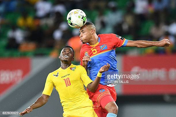 TOPSHOT Democratic Republic of the Congo's defender Marcel Tisserand heads the ball with Togo's midfielder Floyd Ayite during the 2017 Africa Cup of...