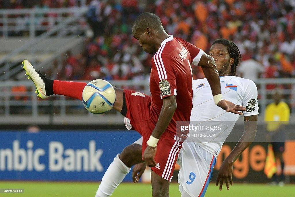 Democratic Republic of the Congo's forward Dieudonne Mbokani (R) vies with Congo's defender Boris Moubio Ngonga during the 2015 African Cup of Nations quarter final football match between Congo and Republic of the Congo in Bata, on January 31, 2015.
