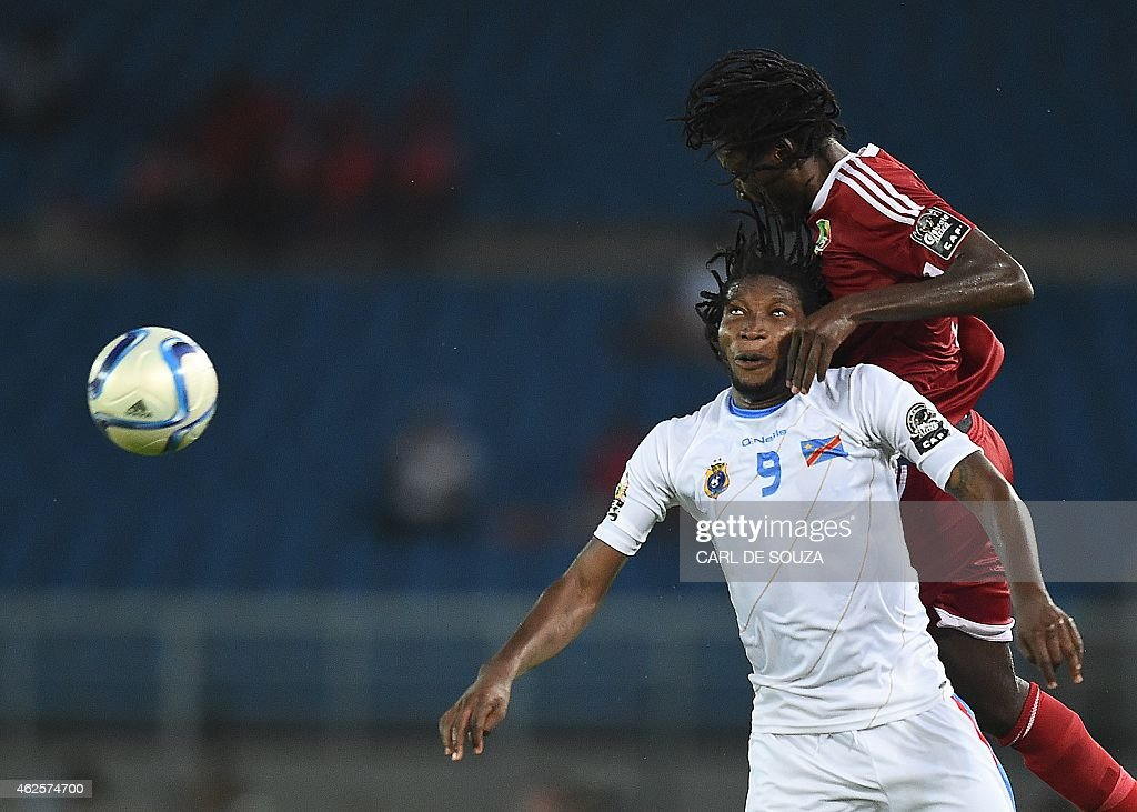 Democratic Republic of the Congo's forward Dieudonne Mbokani (L) vies with Congo's defender Dimitry Davy Magnokele Bissiki during the 2015 African Cup of Nations quarter final football match between Congo and Republic of the Congo in Bata, on January 31, 2015.