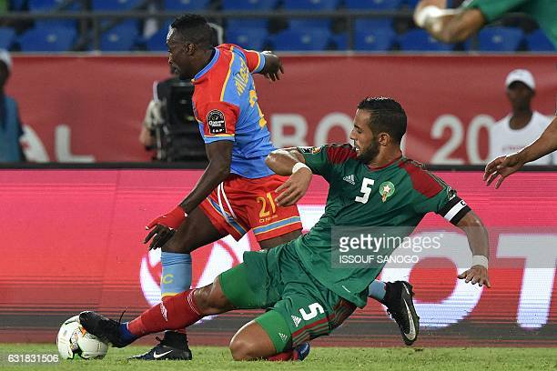 Democratic Republic of the Congo's forward Firmin Ndombe Mubele challenges Morocco's defender Mehdi Benatia during the 2017 Africa Cup of Nations...