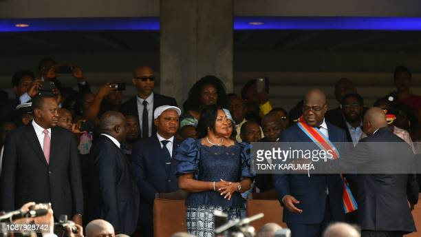 Democratic Republic of the Congo's newly inaugurated President Felix Tshisekedi is congratulated by DRCongo's outgoing President Joseph Kabila as he...