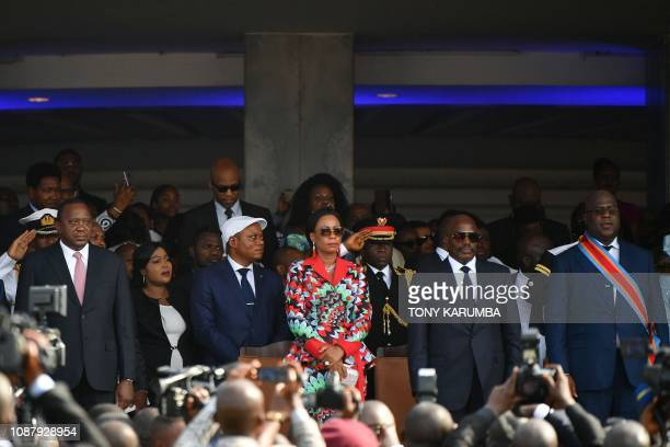 Democratic Republic of the Congo's newly inaugurated President Felix Tshisekedi stands next to DRCongo's outgoing President Joseph Kabila and his...