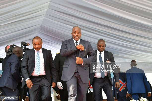 Democratic Republic of the Congo's outgoing President Joseph Kabila walks off the podium on January 24 2019 after he officially handed over the...