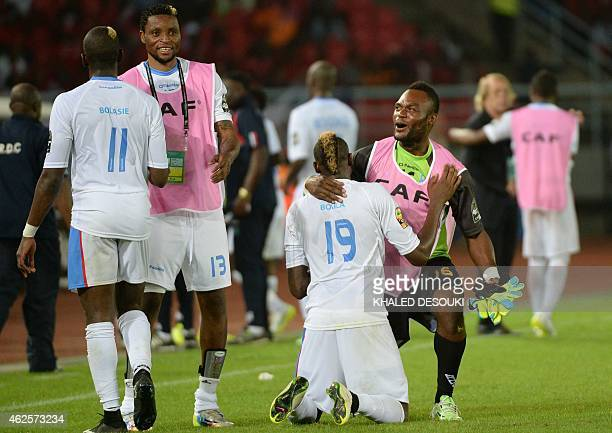 Democratic Republic of the Congo's players celebrate at the end of the 2015 African Cup of Nations quarter final football match between Congo and...
