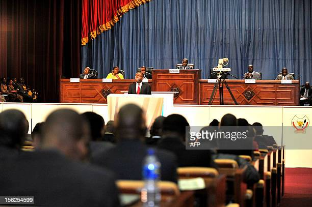 Democratic Republic of the Congo's Prime Minister Augustin Matata Ponyo speaks and defends the 2013 budget at the National Assembly in Kinshasa on...