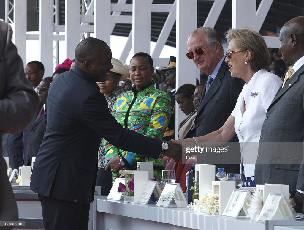 Democratic Repuplic of Congo President Joseph Kabila shakes hands with King Albert II of Belgium and Queen Paola of Belgium (R) as they attend the 50th anniversary parade marking the independence of the Democratic Republic of Congo on June 30, 2010 in Kinshasa, Democratic Repuplic of Congo. King Albert II of Belgium and Queen Paola of Belgium are on a 3 day state visit and and as guests of the 50th anniversary celebrations.