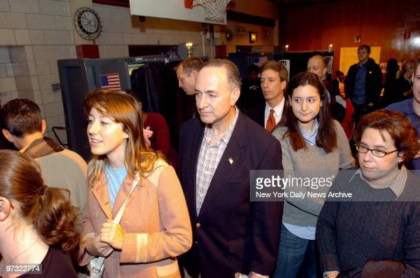 Democratic Sen Chuck Schumer stands in line while waiting to vote at Public School 321 in Park Slope Brooklyn He's preceded by his wife city...