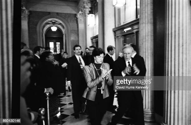 Democratic Sen Harry Reid of Nevada walks and talks with a reporter in the hallway of the US Capitol Building the day before the start of the...