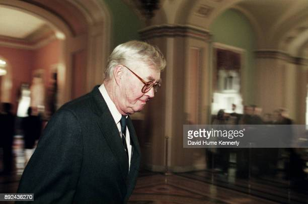 Democratic Sen Patrick Moynihan of New York walks through the hallways of the US Capitol Building during a break from the Senate Impeachment Trial of...