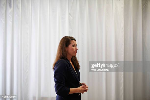 Democratic Senate candidate and Kentucky Secretary of State Alison Lundergan Grimes waits to speak off stage at the United Auto Workers hall November...
