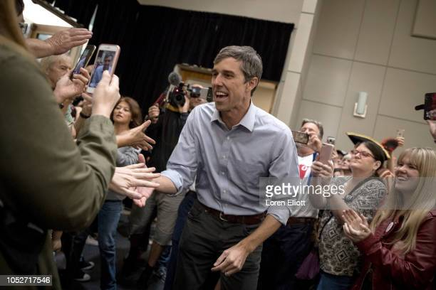 Democratic Senate candidate Beto O'Rourke greets supporters while making his way toward the stage at a campaign rally on October 21 2018 in Conroe...