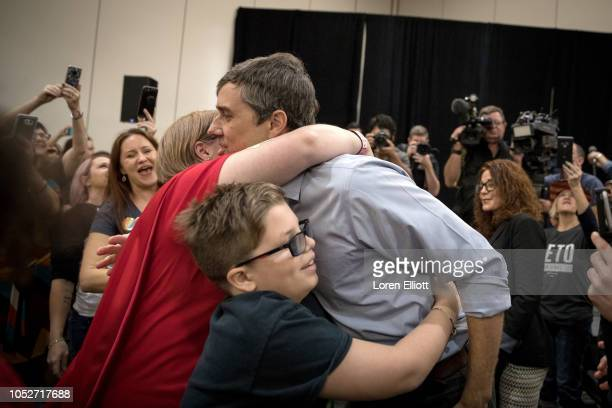 Democratic Senate candidate Beto O'Rourke hugs Rhonda Hart and Tyler Vaughan the mother and brother of Santa Fe High School shooting victim Kimberly...