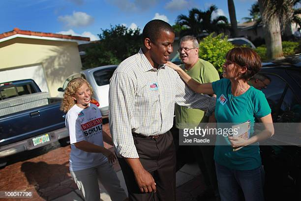 Democratic Senate candidate Rep Kendrick Meek and Rep Debbie Wasserman Schultz are greeted by John Blanco and Teresa Blanco as they canvas a...