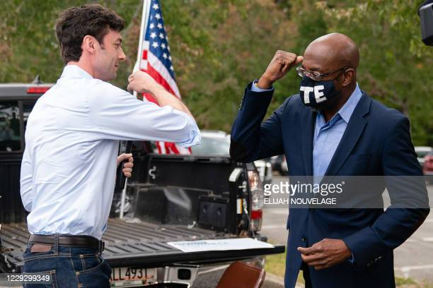 Democratic Senate candidates Jon Ossoff and Rev. Raphael Warnock, bump elbows at a rally on October 24 in Duluth, Georgia. - Neighbors and volunteers...