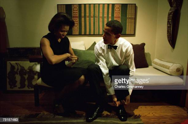 Democratic Senator Barack Obama and his wife Michelle get ready at their home on December 8 2004 in Chicago Illinois The Senator will give the...