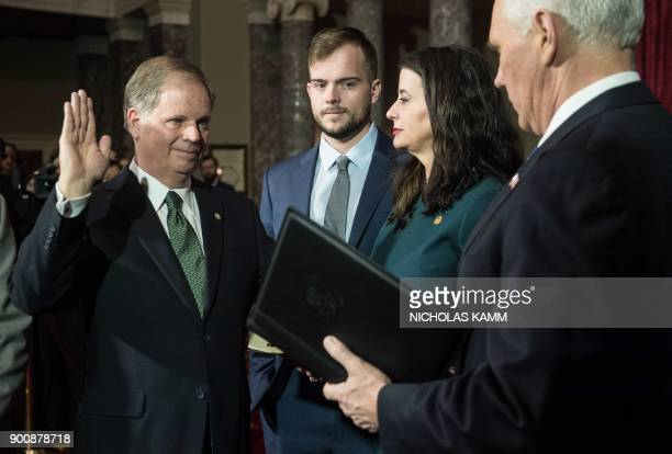 US Democratic Senator from Alabama Doug Jones is ceremonially sworn in by Vice President Mike Pence at the Capitol in Washington DC on January 3 2018...