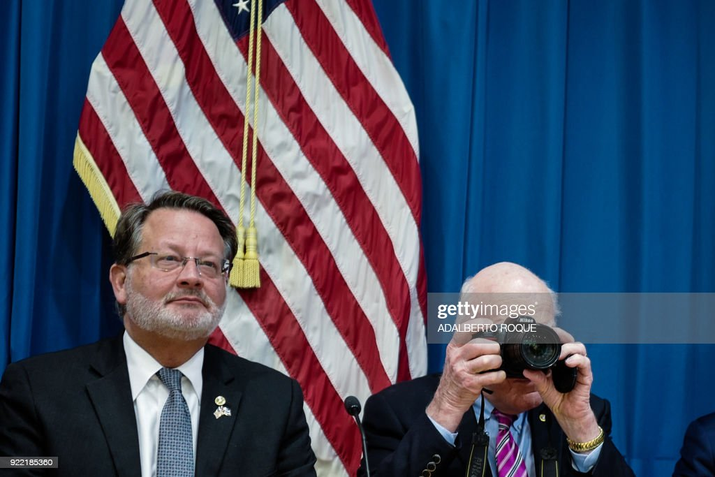 US Democratic Senator Patrick Leahy from Vermont (R) takes pictures during a press conference at the United States Embassy in Havana on February 21, 2018. Cuban President Raul Castro Tuesday received a bipartisan delegation of US lawmakers Tuesday, who are visiting the island with the alleged 'acoustic attacks' against US diplomats on their agenda. /