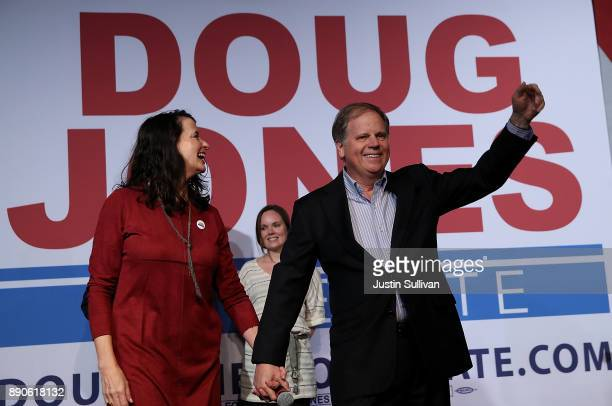 Democratic Senatorial candidate Doug Jones and his wife Louise Jones greet supporters during a get out the vote campaign rally on December 11 2017 in...