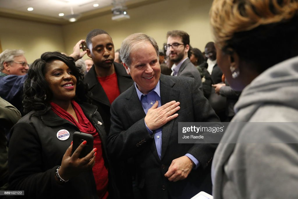 Democratic Senatorial candidate Doug Jones greets people during a campaign event held at Alabama State University at the John Garrick Hardy University Student Center on December 9, 2017 in Montgomery, Alabama. Mr. Jones is facing off against Republican Roy Moore in next week's special election for the U.S. Senate.