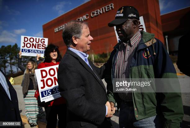 Democratic Senatorial candidate Doug Jones greets voters outside of a polling station at the Bessemer Civic Center on December 12 2017 in Bessemer...