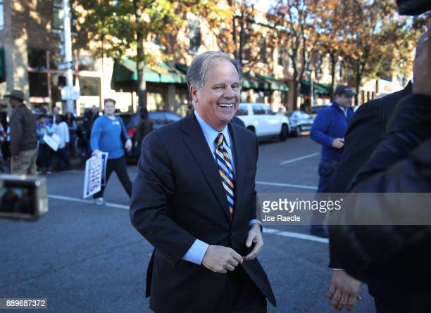 Democratic Senatorial candidate Doug Jones leaves after a campaign stop at a Jones for Senate field office on December 10 2017 in Birmingham Alabama...