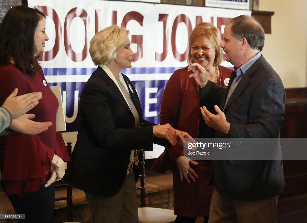 Democratic Senatorial candidate Doug Jones prepares to hug Lilly Ledbetter as his wife Louise Jones (L) and former Alabama First Lady Marsha Folsom (R) look on during a 'Women's Wednesday' campaign event on December 6, 2017 in Cullman, Alabama. Mr. Jones is facing off against Republican Roy Moore in next week's special election for the U.S. Senate.