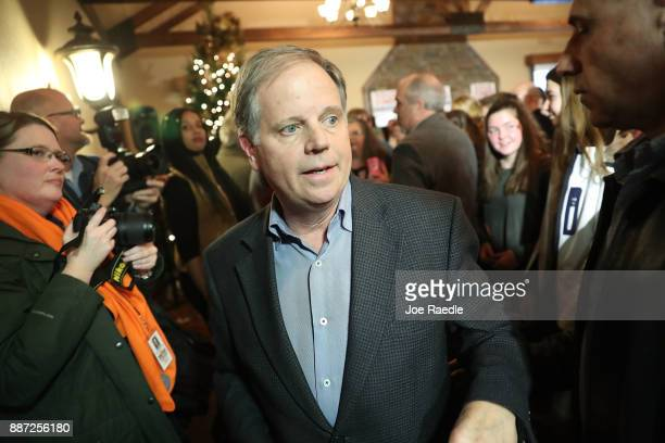 Democratic Senatorial candidate Doug Jones prepares to leave after hosting a 'Women's Wednesday' campaign event on December 6 2017 in Cullman Alabama...