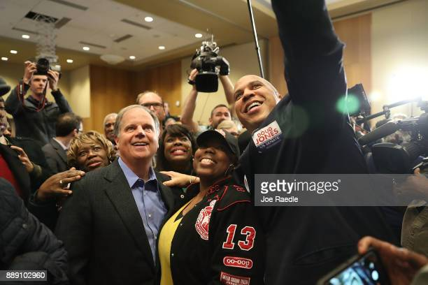 Democratic Senatorial candidate Doug Jones takes a group picture with Sen Cory Booker and Rep Terri Sewell and supporters during a campaign event...