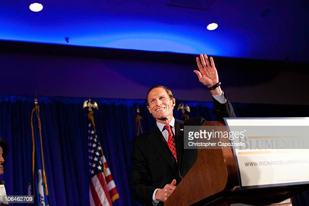 Democratic senatorial candidate Richard Blumenthal waves as he announces his victory over Republican Linda McMahon during an election night event at...