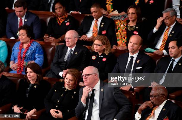 Democratic Senators House representative and guests sit and look on as US President Donald Trump delivers the State of the Union address at the US...