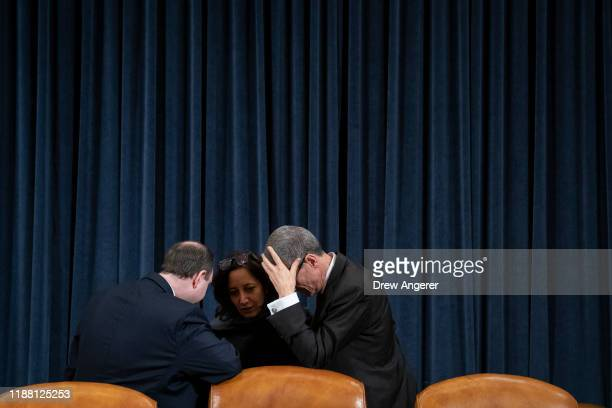 Democratic staff members confer during a break in a House Judiciary Committee markup hearing on the articles of impeachment against U.S. President...