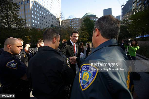 Democratic state attorney general candidate Andrew Cuomo shakes hands with police officers at the Police Memorial in Battery Park City where he spoke...
