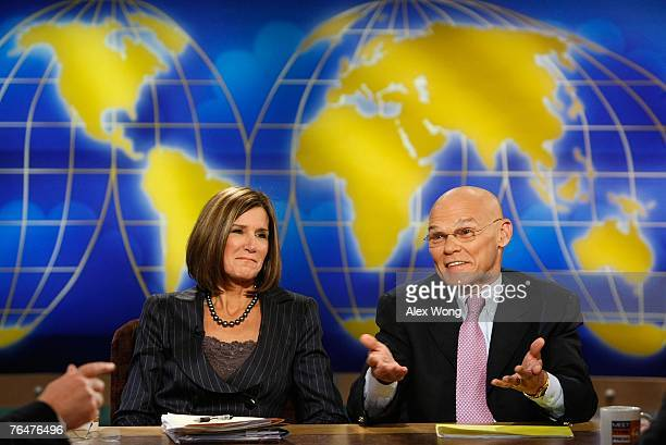 Democratic strategist James Carville speaks as Carville's wife and Republican strategist Mary Matalin listens during a taping of Meet the Press at...