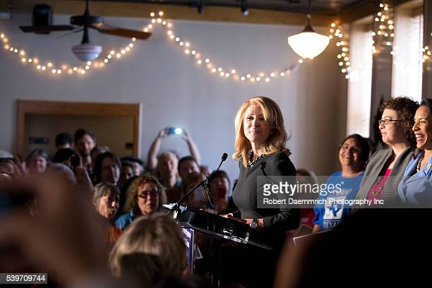Democratic Texas governor candidate Wendy Davis speaks at a Scholtz' Garten beer hall rally advocating equal pay for equal work after surveys suggest...