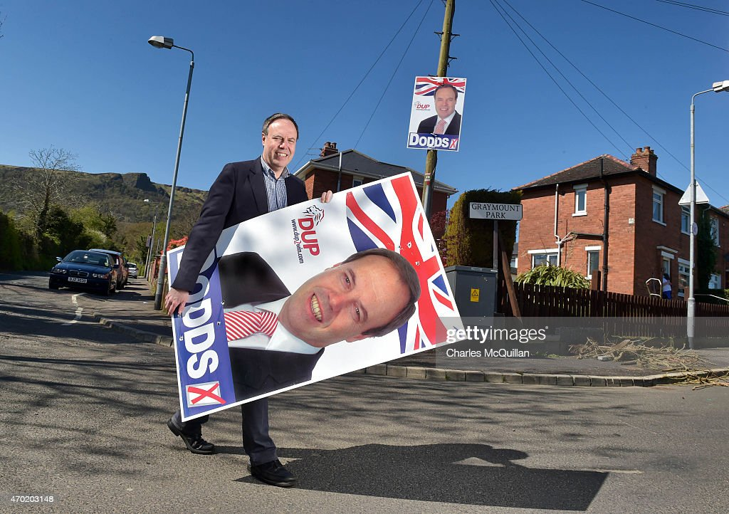 Democratic Unionist Party Deputy Leader, Nigel Dodds carries a large poster as he canvasses for the general election on April 18, 2015 in Belfast, Northern Ireland. Many political observers have predicted that the DUP may have a key Westminster role in deciding who will form the next government if the general election results in a hung parliament. Nigel Dodds will be the most prominent DUP member at Westminster if re-elected.