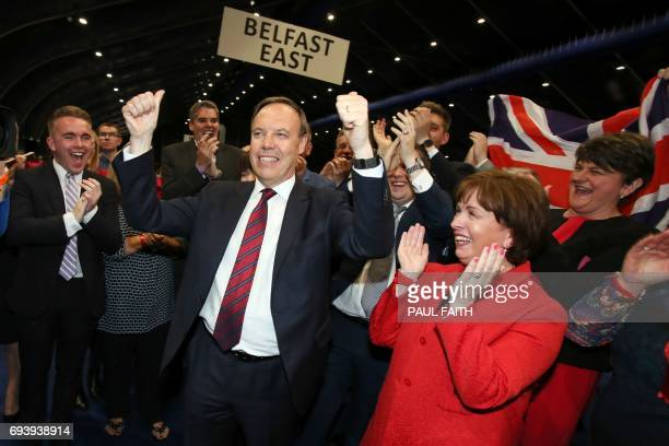 Democratic Unionist Party deputy leader Nigel Dodds celebrates winning his Belfast North seat at the counting centre in Belfast Northern Ireland...