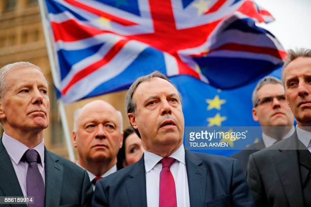 Democratic Unionist Party Deputy Leader Nigel Dodds speaks to journalists outside the Houses of Parliament in central London on December 5 as...