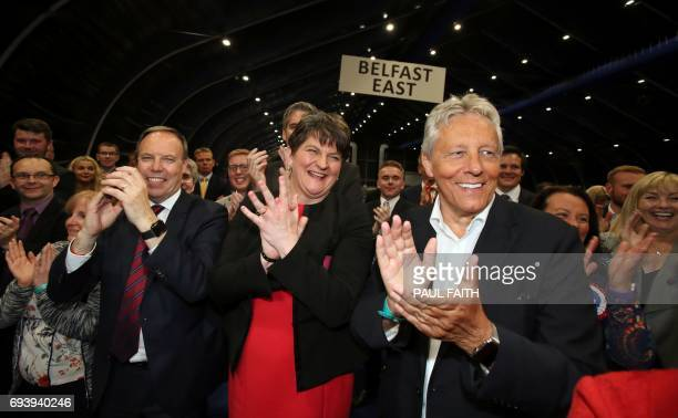 Democratic Unionist Party deputy Nigel Dodds leader Arlene Foster and Former Democratic Unionist Party Leader Peter Robinson celebrate at the...