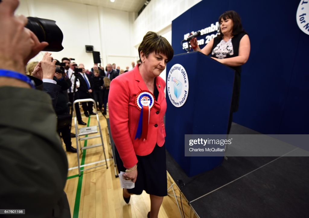 Democratic Unionist party leader and former First Minister Arlene Foster exits the stage after making her speech watched by Michelle Gildernew of Sinn Fein (R) as the Northern Ireland Stormont election count takes place at the Omagh Leisure centre on March 3, 2017 in Omagh, Northern Ireland. Voters went to the polls yesterday for the second time in 10 months after the collapse of the power sharing executive government.