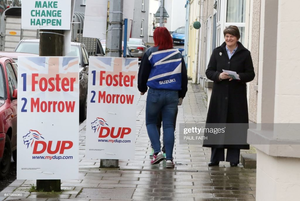 Democratic Unionist Party (DUP) Leader, and former Norther Ireland First Minister, Arlene Foster poses for a photo after casting her vote in the Northern Ireland Assembly elections, at Brookeborough Primary School in Brookeborough on March 2, 2017. Northern Ireland began voting Thursday in snap elections to resolve a political crisis fuelled by bad blood and Brexit, which is testing the delicate peace in the British province. / AFP PHOTO / Paul FAITH