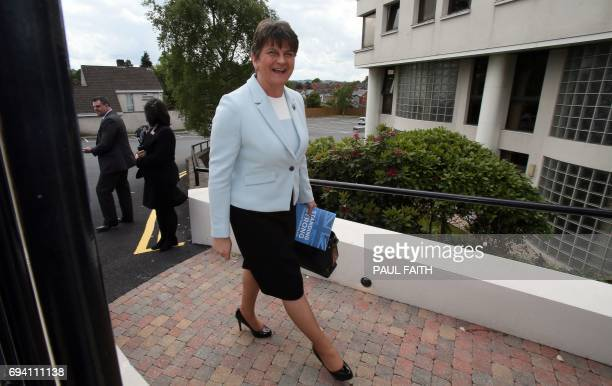 Democratic Unionist Party leader and former Northern Ireland First Minister Arlene Foster reacts as she arrives at the Stormont Hotel in Belfast...