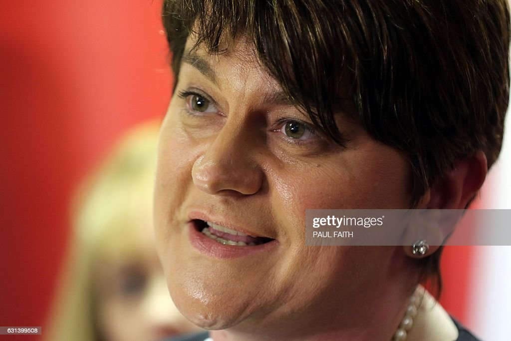 Democratic Unionist Party (DUP) leader and Outgoing Northern Ireland First Minister, Arlene Foster, speaks at the DUP headquarters in Belfast on January 10, 2017, on the political situation following the resignation of Deputy First Minister Martin McGuinness. Northern Ireland's government was on the brink of collapse after Deputy First Minister Martin McGuinness resigned Monday, the latest twist in a tumultuous career for the former IRA commander. The move by McGuinness, a senior member of the republican Sinn Fein party and a top paramilitary leader in the 1970s, could trigger new elections in the semi-autonomous province within weeks. In standing down, McGuinness voiced anger over a botched renewable energy subsidy scheme, a scandal that has been simmering in Northern Ireland for weeks. He accused First Minister Arlene Foster and her Democratic Unionist Party of 'arrogance' over the scheme, which is likely to leave taxpayers with a bill running into millions of pounds. / AFP / Paul FAITH