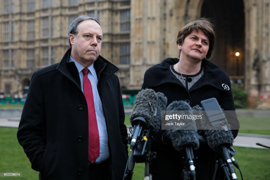 Democratic Unionist Party (DUP) Leader Arlene Foster (R) and Deputy Leader Nigel Dodds (L) make a statement on College Green in Westminster on February 21, 2018 in London, England. British Prime Minister Theresa may has met with leaders of the DUP and Sinn Fein in an effort to restore progress on power sharing in the country.