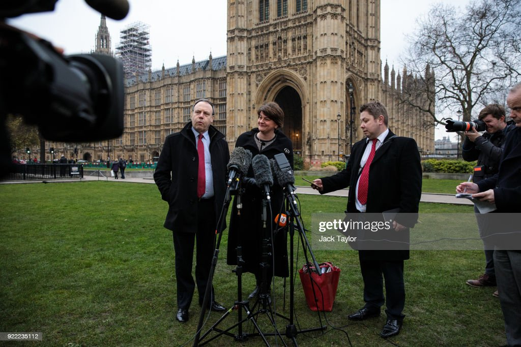 Democratic Unionist Party (DUP) Leader Arlene Foster (C) and Deputy Leader Nigel Dodds (L) make a statement on College Green in Westminster on February 21, 2018 in London, England. British Prime Minister Theresa may has met with leaders of the DUP and Sinn Fein in an effort to restore progress on power sharing in the country.
