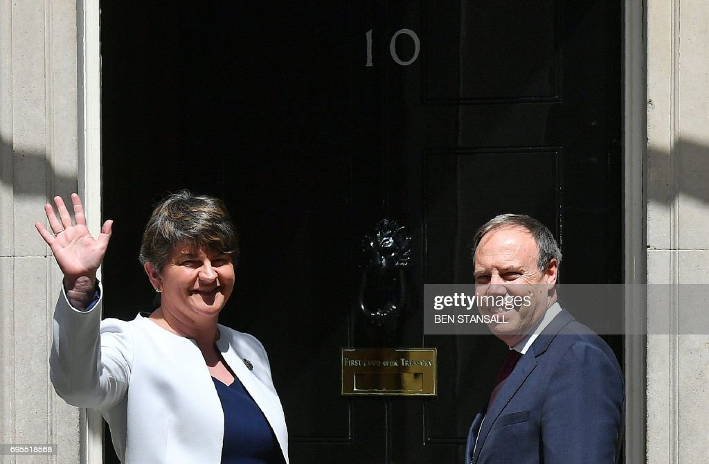 Democratic Unionist Party (DUP) leader Arlene Foster (L), and DUP Deputy Leader Nigel Dodds arrive at 10 Downing Street in central London on June 13, 2017, for a meeting with Britain's Prime Minister and Conservative Party leader Theresa May. British Prime Minister Theresa May on Tuesday was heading into difficult talks with the DUP on securing a working majority after a crushing electoral setback. / AFP PHOTO / Ben STANSALL