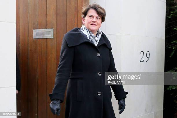 Democratic Unionist Party leader Arlene Foster comes out to speak to members of the media in Belfast on February 8 after talks with Ireland's Prime...