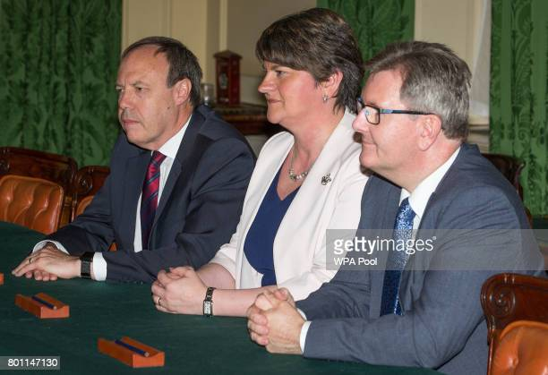 Democratic Unionist Party leader Arlene Foster DUP Deputy Leader Nigel Dodds and DUP MP Jeffrey Donaldson speak to Prime Minister Theresa May First...