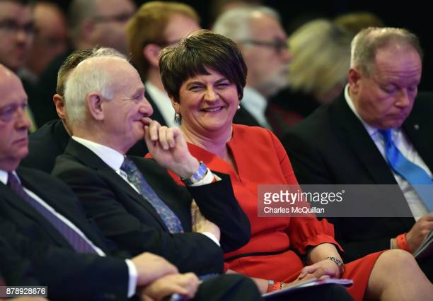 Democratic Unionist Party leader Arlene Foster jokes with party members before giving her leader's speech during the annual DUP party conference at...